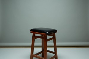 Image of bar stool in front of backdrop